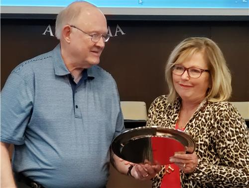 Mr. Larry Boswell, LCBOE president presents Mrs. Judy Flournoy with plaque.
