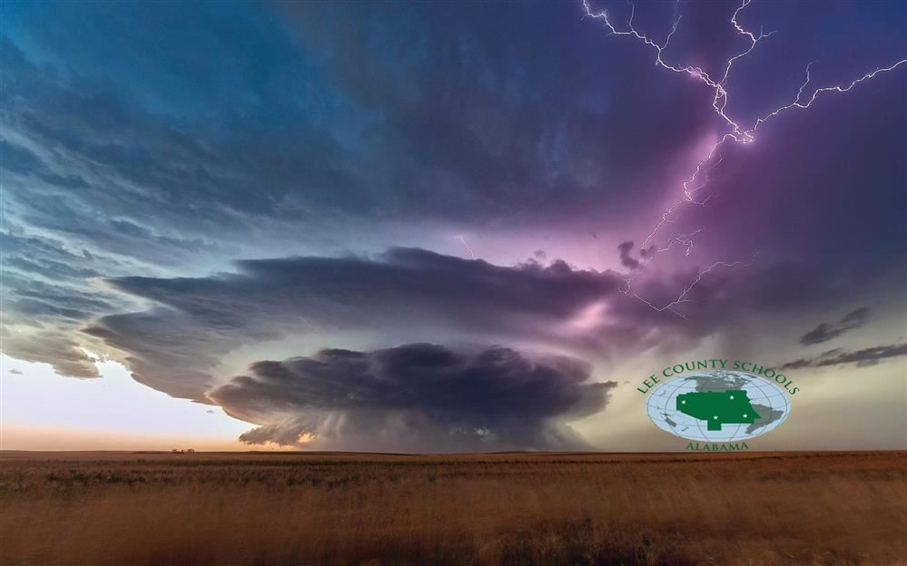 Image of tornado over a field with Lee County Logo