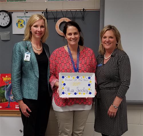 Teacher of the Year, Mrs. Seeley, with Cynthia Meals and Lisa Harris